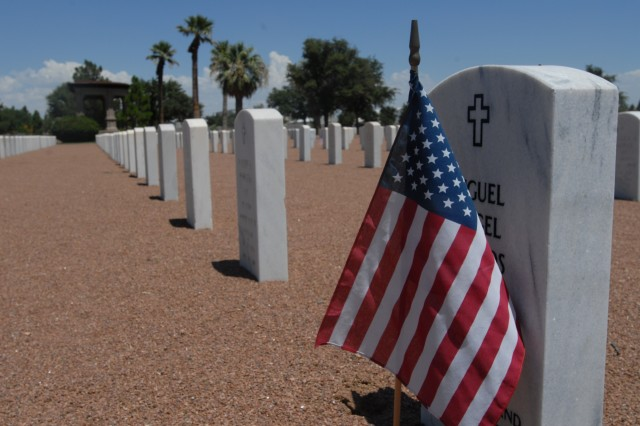 American flags are placed at many of the gravesites at the Fort Bliss National Cemetery. The cemetery has begun an expansion project to increase burial capacity and continue servicing the Veterans of western Texas and southern New Mexico. (U.S. Army photo by Pfc. Jennifer Kennemer, 16th MPAD)