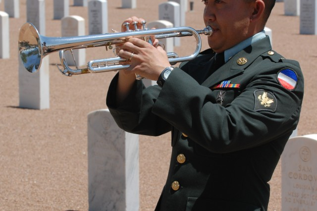 Spc. Allanphoe H. Lagrisola, 62nd Army Band, performs at the Fort Bliss National Cemetery July 15. (U.S. Army photo by Pfc. Jennifer Kennemer, 16th MPAD)