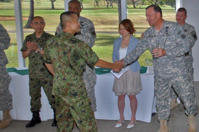 FORT SHAFTER, Hawaii – Lt. Gen. Benjamin R. Mixon, commanding general, U.S. Army, Pacific, welcomes Maj. Gen. Hiromichi Kawamata, deputy chief of staff, Northern Army, Japan Ground Self Defense Force, at the opening social event for Yama Sakura 56 Staff Exercise.