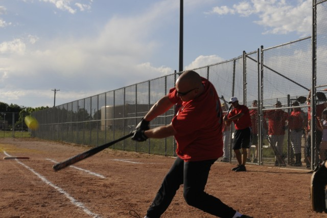 Maj. Chad Witt, Current Operations Officer, 100th Missile Defense Brigade (Ground-based Midcourse Defense) slaps a softball deep into right-center field during a softball game on Peterson Air Force Base. The 100th MDB's softball team is currently undefeated in the PAFB silver intramural softball league and looking forward to entering the playoffs undefeated on July 28.