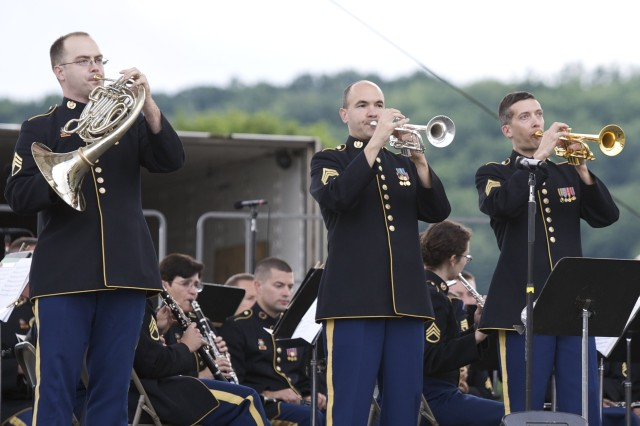Staff Sgt. Stephen Aaron on the french horn, Sgt. 1st Class Michael Klima (center) playing trumpet and Staff Sgt. Nick Althouse also on the trumpet, get ready to perform for thousands at the Cynthia Woods Mitchell Pavilion in The Woodlands, Texas, at 7:30 p.m. July 28.