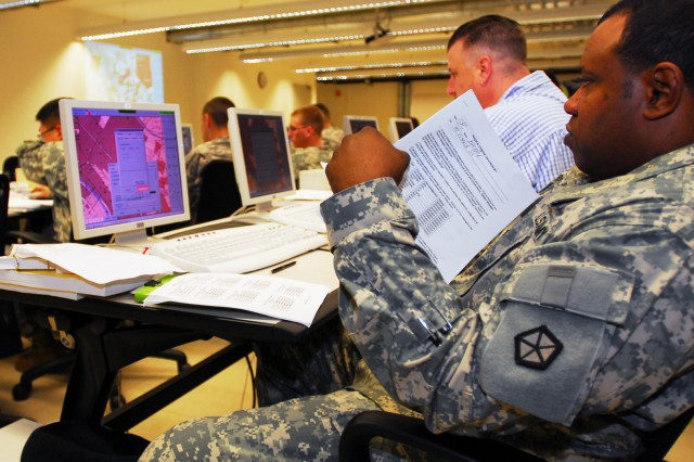 Sgt. 1st Class Michael L. Broady, U.S. Army, Europe headquarters, learns how to operate the tracking system during a Blue Force Tracker course at Joint Multinational Training Command's Digital University, June 15 in Grafenwoehr, Germany.
