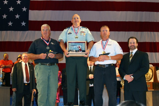 Sgt. 1st Class James Henderson (center), is applauded after being named the 2009 National Pistol Champion, July 18. Henderson is the first active-duty Soldier to win the top prize since 1985.