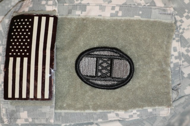 """BAGHDAD - The 30th Heavy Brigade Combat Team's patch carries a great deal of symbolism for the brigade, which started life as an infantry division in World War I.    The name, Old Hickory, refers to the nickname of former Soldier and President Andrew Jackson, who was born near North Carolina's border with South Carolina.  The black outline of the patch represents the letter """"O"""" and the inner lines represent the letter """"H.""""   The three """"X's in the """"H"""" are the Roman numerals for 30.   The black and green patch is for use on the Army's combat uniform; on the Army's dress uniforms the patch outline is in royal blue and the inside is scarlet red."""