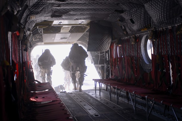 TAJI, Iraq- Soldiers from both the 3rd Brigade Combat Team, 82nd Airborne Division and the Iraqi Army make a rapid departure from a CH-47F Chinook helicopter before they perform a clearing operation, July 20, outside Ma-mil powerstation, Iraq. The air assault teams were flown into their area of operation by 2nd Battalion, 227th Aviation Brigade, 1st Air Cavalry Brigade, 1st Cavalry Division, Multi-National Division - Baghdad.