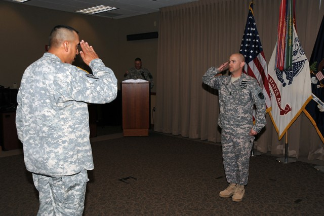 U.S. Army Space and Missile Defense Command/Army Forces Strategic Command's Command Sgt. Maj. Ralph C. Borja receives a salute from incoming Headquarters and Headquarters Company 1st Sgt. William Murphy during a June 5 Change of Responsibility Ceremony at Peterson Air Force Base's Building 3.