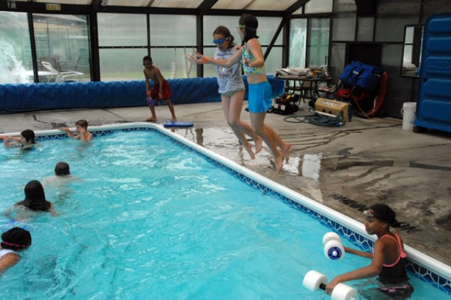 Children learn and play in Camp Adventure