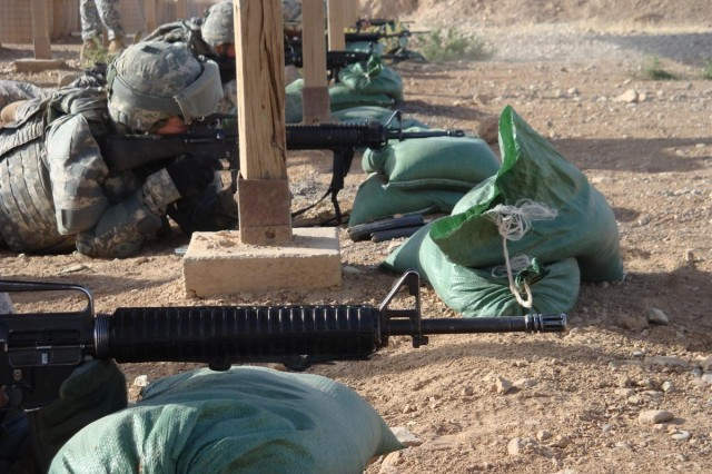 Soldiers from 16th Special Troops Battalion, 16th Sustainment Brigade, take aim at their targets during a qualification range at Contingency Operating Base Q-West, Iraq June 22.