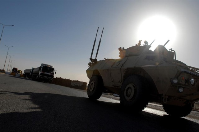 Texas Guardsmen with 2nd Battalion, 142nd Infantry Regiment escort fuel trucks back across the Iraqi/Jordanian border at Trebil Gate Feb. 14. A significant portion of the fuel used by Coalition forces throughout Iraq is transported from Jordan and escorted to hubs such as Al Asad Air Base