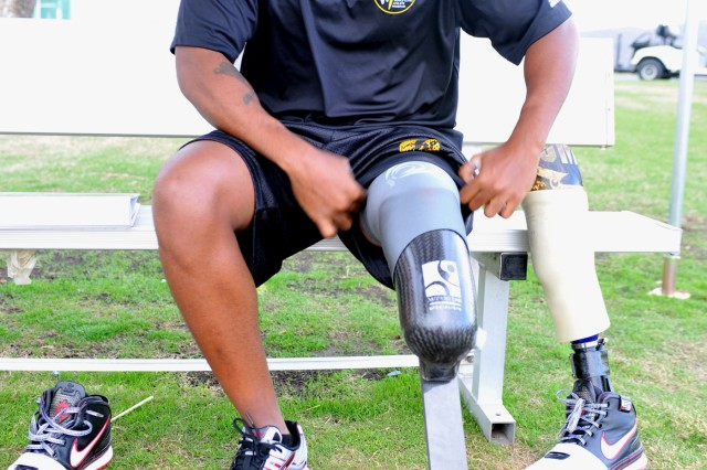 U.S. Army World Class Athlete Program Paralympic sprinter hopeful Sgt. Jerrod Fields changes his prosthesis before running a track workout at the U.S. Olympic Training Center in Chula Vista, Calif.