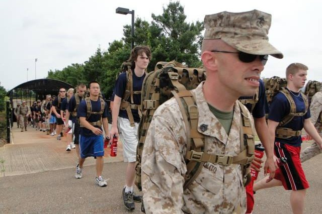 "Staff Sgt. Victor Polito, a Marine recruiter from Albertville, helps lead Marine recruits Aca,!"" known as poolies Aca,!"" through John Hunt Park during a 5.5 mile hike."