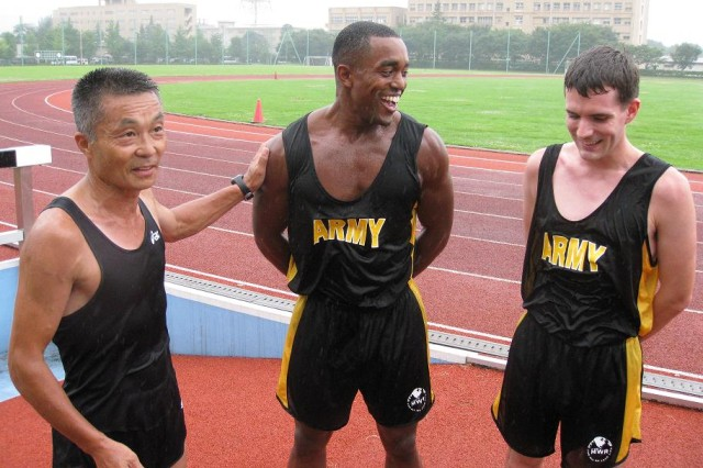 From left: Japan Self Defense Olympic running coach, Major Yoshio Tani, briefs performance assessment for U.S. Army Japan run team members 1Lt Darrius Glover and Spc. Wilbert Litzinger at the JDS Physical Training School at Camp Asaka, Japan July 21, 2009. U.S. ARMY JAPAN PHOTO