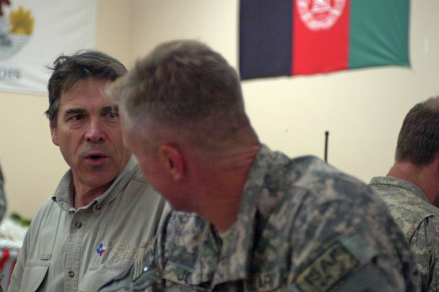 Gov. Rick Perry, governor of Texas, speaks with Texas Soldiers at Forward Operating Base Ghazni, July 21. Governor Perry toured Afghanistan with four other governors checking up on Soldiers and the progress being made. (Photo by U.S. Army Pfc. Derek L. Kuhn, 40th Public Affairs Detachment)