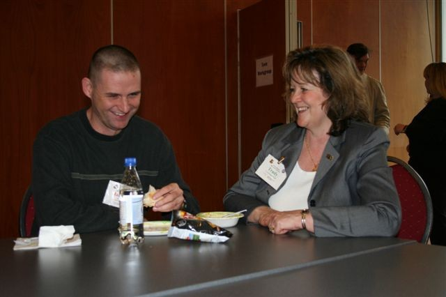 Trudy Wheatley (R), USAG Schinnen's AFAP Coordinater, chats with Sgt. Jameson Brown, one of the Tri-Border AFAP attendees.
