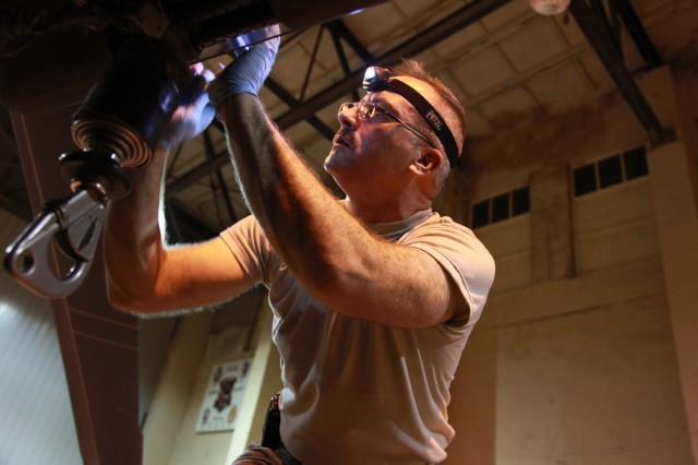 BAGRAM AIR FIELD, Afghanistan -- U.S. Army Sgt. Patrick Purtle, from Mather, Calif., assigned to Company C, 1-168th Aviation Regiment, performs mechanical repairs on a UH-60 Black Hawk helicopter at Bagram Airfield, Afghanistan on July 20, 2009. (Photo by U.S. Army Sgt. Teddy Wade, 55th Signal Company)