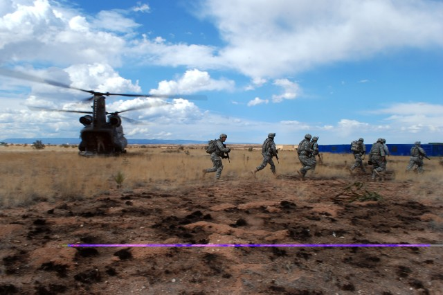 Soldiers from Headquarters and Headquarters Company, 1st Brigade, 37th Armor Regiment stationed at Fort Bliss are inserted by a Chinook from Company B, 2nd Battalion, 3rd Aviation Regiment, while participating in an air assault exercise at Camp McGregor, Fort Bliss, Texas.