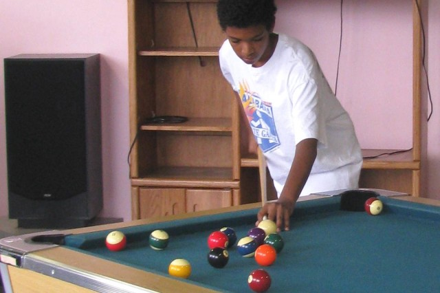 Matthew Thompson practices a bank shot at the Youth Center.
