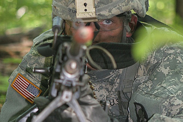 Yearling David Junta, of 1st Company, Cadet Field Training from Springfield, Va., takes aim with his M249 light machine gun while in the prone position during Intro to Patrolling at Camp Buckner July 13.