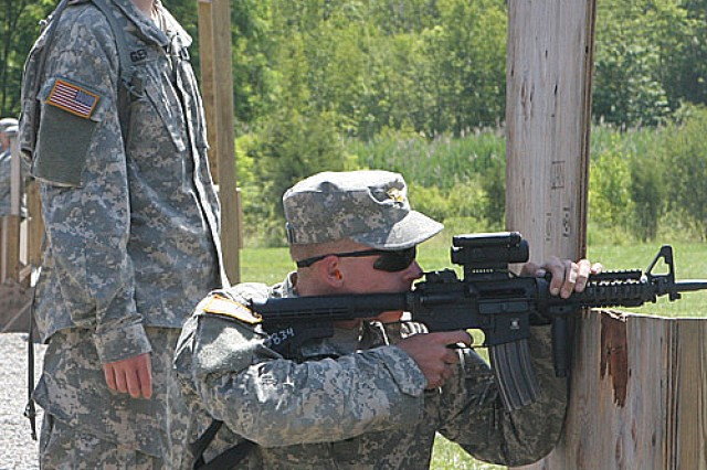 Yearling Talon Erickson, right, shoots targets on Range 5 while Cow Nicole Singer reviews his proficiency for Recondo badge qualification July 13.