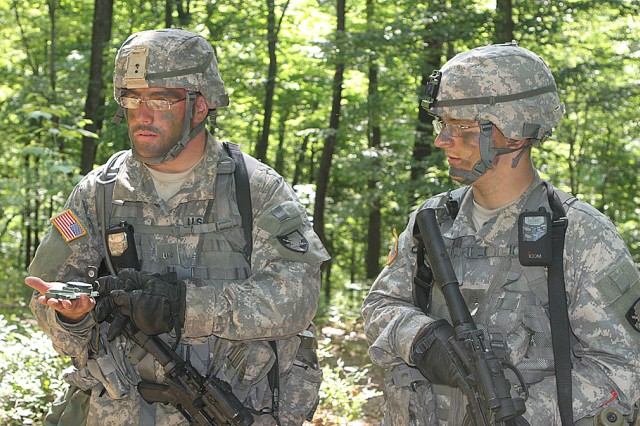 Yearling team leader Justin Schaaf, left, 1st Company, Cadet Field Training, from Erie, Pa., discusses the direction of a patrol with his squad leader, Cow Christopher Einig, 1st Co., CFT, from St. Louis, during Introduction to Patrolling at Camp Buckner July 13. The new CFT curriculum was almost completely cadet-driven, relying much less on a summer task force or tactical officers and NCOs than in previous summers.