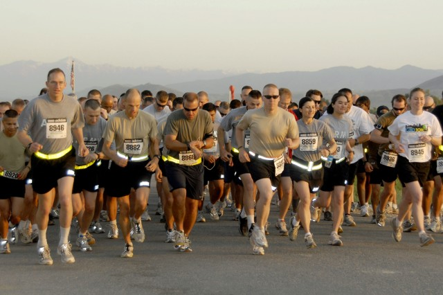 Participants in the 2009 Fleet Feet Soldier Field 10-miler shadow run, at Forward Operating Base Fenty, Afghanistan, cross the starting line. The run at FOB Fenty was a satellite run of the 2009 Fleet Feet Soldier Field 10-miler held in Chicago, May 23.