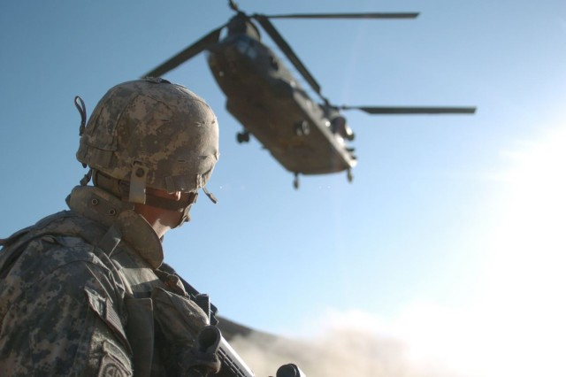 1st Lt. Dennis Chamberlain watches an air-support helicopter approach during his deployment to Afghanistan.