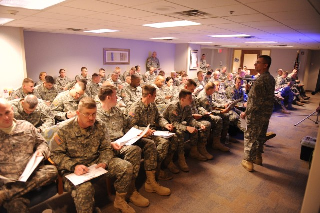 Soldiers wait for their turn to meet with healthcare provider.