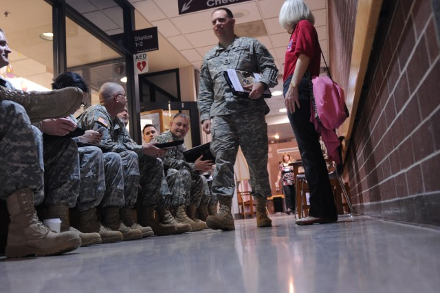 Soldiers wait to complete the PDHRA screening process.