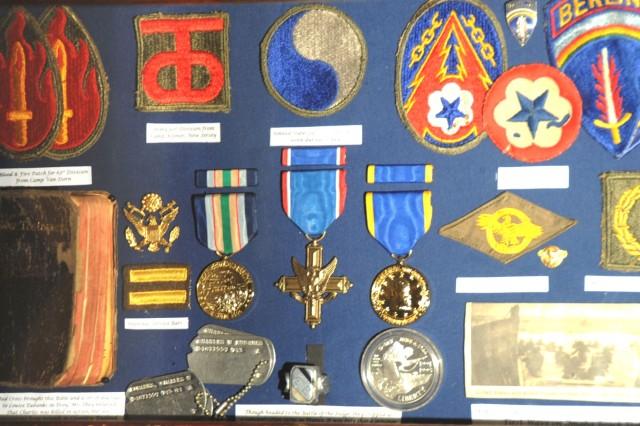 Pfc. Charles Eubanks' World War II awards, Bible, patches and memorabilia.