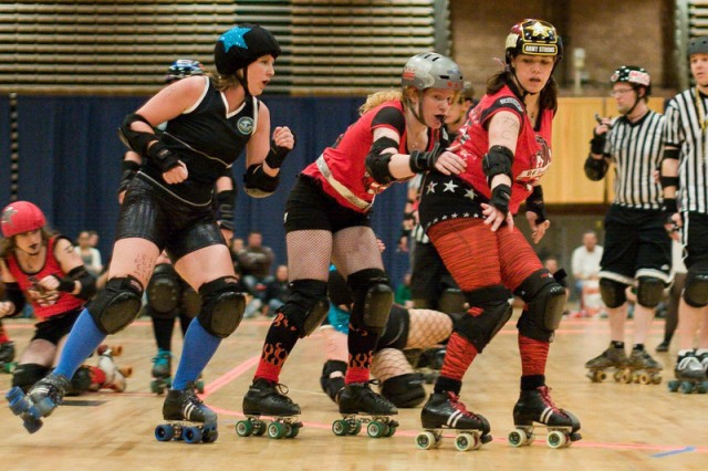 Hooah!Girl blocks opposing jammer Dr. Skabs with help from ShREDica.
