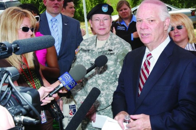 U.S. Sen. Benjamin Cardin (D-Md.) speaks with media during a tour of landfill capping sites at Fort Detrick, Md.