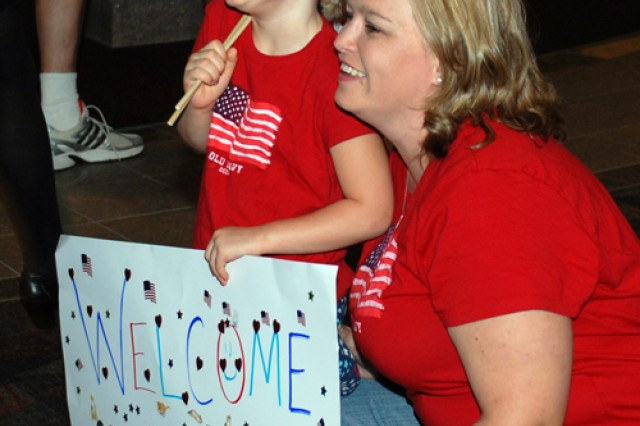 COLORADO SPRINGS, Colo. - Sgt.  Patrick Sawyckyj's daughter Michaela and wife Sheila await his arrival with a homemade sign.
