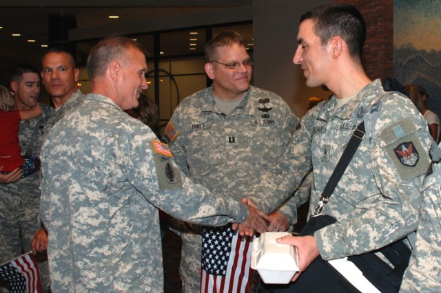 COLORADO SPRINGS, Colo. - Brig. Gen. Stuart C. Pike, Assistant Adjutant General for Space, Colorado National Guard, welcomes back ARSST 27 member Staff Sgt. Joseph Brusky as Capt. James  Innes, assistant operations officer, 117th Space Battalion COARNG looks on.