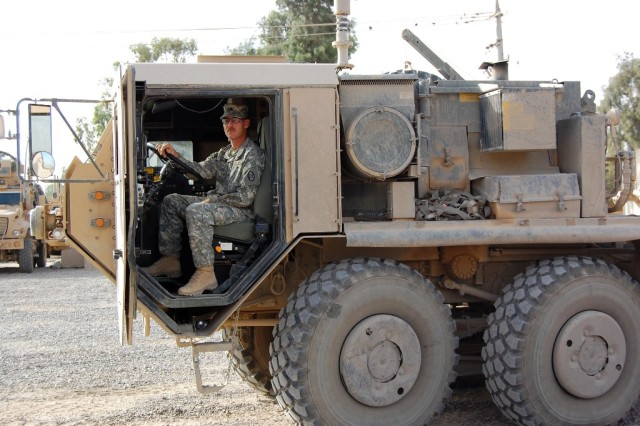 BAGHDAD - Sgt. Jeremy Brown, a supply sergeant with 230th Brigade Support Battalion, 30th Heavy Brigade Combat Team, sits in one of the heavy-wheeled vehicles he drives while deployed in Iraq, July 18. This is his second Iraq deployment with his two brothers, Poleman and David Brown. The three brothers say they have already decided they will deploy again if one of them gets called for service in the future.