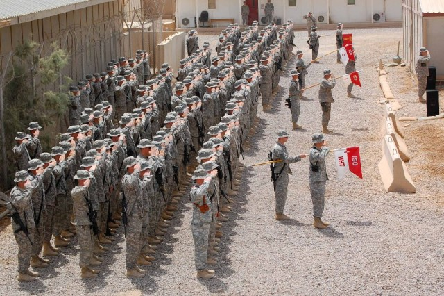 """BAGHDAD - Soldiers of 150th Armored Reconnaissance Squadron salute during """"The Star-Spangled Banner"""" at their combat patch ceremony July 22, at Camp Stryker. The Soldiers were awarded the Old Hickory patch from the 30th Heavy Combat Team commander in recognition of their wartime service. The squadron is based out of Bluefield, W. Va., and its history dates back to the War of 1812."""
