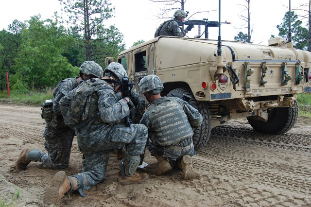 Lt. Frank Kraut (right), platoon leader of the Military Police Platoon from Headquarters Company, Brigade Special Troops Battalion, 2nd Brigade Combat Team, 82nd Airborne Division briefs his squad leaders on a hastily developed plan to search a village suspected of harboring enemy fighters during the BSTB's convoy live fire training exercise July 22. (U.S. Army photo by Staff Sgt. Mike Pryor, 2nd BCT, 82nd Abn. Div. Public Affairs)