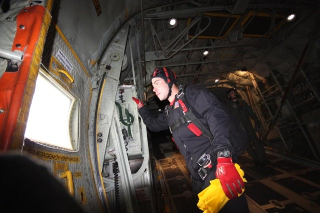 Staff Sgt. Jason Spinnicchia checks out the area from the C130 before his team parachutes in to the Prairie Air Show in Peoria, IL.