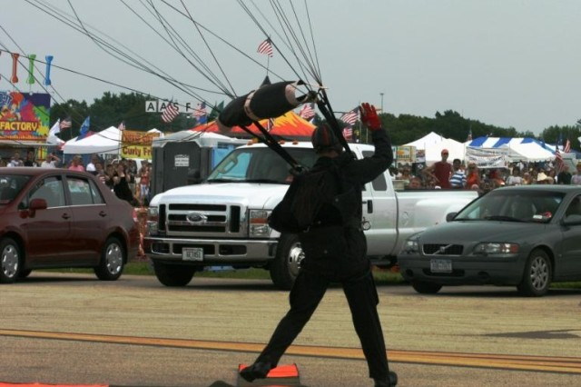 Staff Sgt. Dewey Vinaya lands with precision on target in the parking lot of the Prairie Air Show, Peoria, IL.
