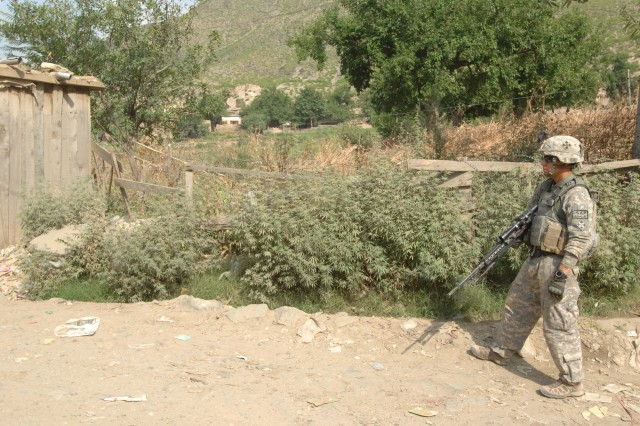 KONAR PROVINCE, Afghanistan - U.S. Army Sgt. Isaac Espurvoa, Company C, 3rd Squadron, 61st Cavalry Regiment, 4th Brigade Combat Team, 4th Infantry Division, maintains security on a road while on a patrol to inspect the structural integrity of a potential voting site in Nishagam village, Afghanistan, July 13.  (Photo by U.S. Army Spc. Evan D. Marcy, 55th Signal Company)