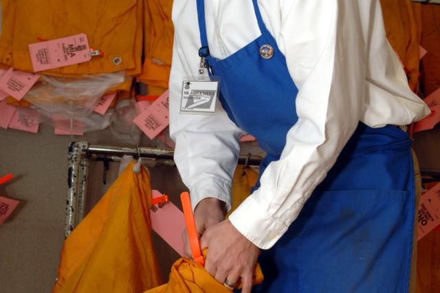 John Little, Mannheim community postmaster, secures a mail bag for shipment.