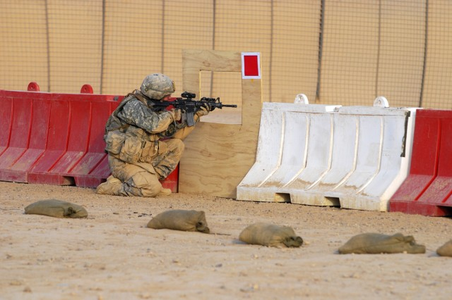 """A Soldier participating in the """"Joint Best Warrior Competition - Multi-National Division - North"""" fires at a set of targets during the stress shooting portion of the event at Contingency Operating Base Speicher, near Tikrit, Iraq, July 27. Participants of the stress shoot were evaluated on their shot accuracy and performance under pressure during the trial. The competition is part of a 4-day physical and mental trial to find the best warrior currently serving in northern Iraq. (U.S. Army photo by Spc. Jared Sollars, 145th Mobile Public Affairs Detachment)"""