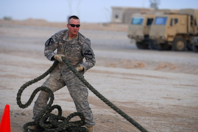 """Spc. Colton Derr, Headquarters and Headquarters Troop, 6 Battalion, 9th Cavalry Regiment, 3rd Heavy Brigade Combat Team, 1st Cavalry Division, pulls a weighted rope as part of a timed physical trial during the fitness test portion of the """"Joint Best Warrior Competition - Multi-National Division - North"""" held at Contingency Operating Base Speicher, near Tikrit, Iraq, July 27. The competition is part of a 4-day physical and mental trial to find the best warrior currently serving in northern Iraq. (U.S. Army photo by Spc. Jared Sollars, 145th Mobile Public Affairs Detachment)"""