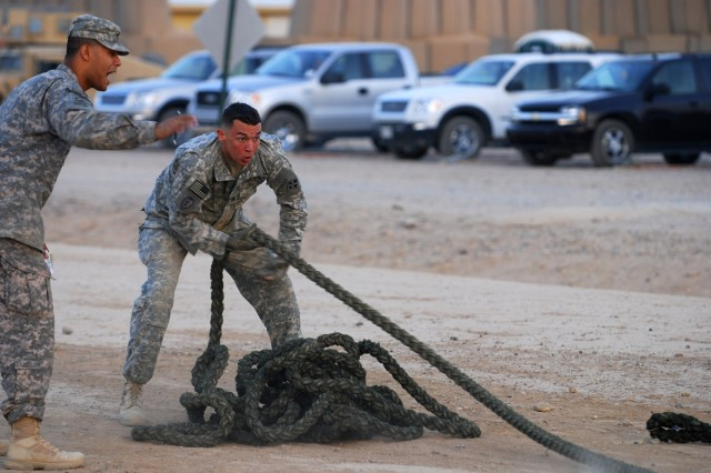 """Staff Sgt. Derek Stephens, Company A, 1st Battalion, 67th Armored Regiment, 3rd Heavy Brigade Combat Team, 1st Cavalry Division, pulls a weighted rope as part of a timed physical trial during the fitness test portion of the """"Joint Best Warrior Competition - Multi-National Division - North"""" held at Contingency Operating Base Speicher, near Tikrit, Iraq, July 27. The competition is part of a 4-day physical and mental trial to find the best warrior currently serving in northern Iraq. (U.S. Army photo by Spc. Jared Sollars, 145th Mobile Public Affairs Detachment)"""