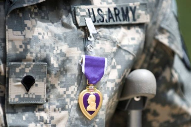 Spc. Tony Guzman wears his Purple Heart medal after a ceremony outside Brooke Army Medical Center at Fort Sam Houston, Texas, on July 23,