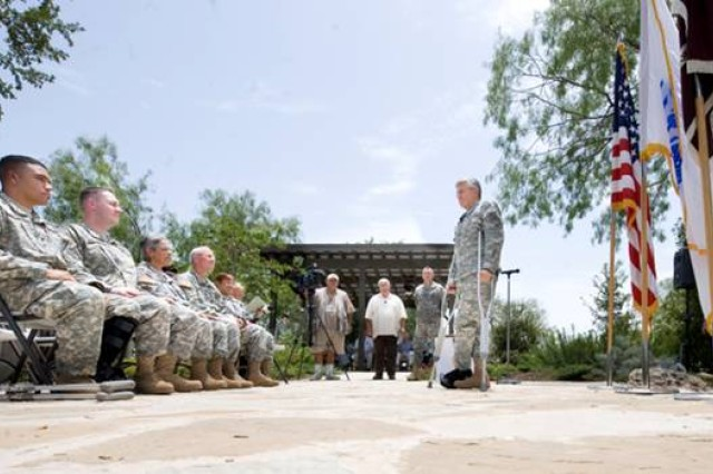 Chief of Staff of the Army Gen. George W. Casey Jr., acknowledges Soldiers and their families before starting a Purple Heart ceremony outside Brooke Army Medical Center at Fort Sam Houston, Texas, on July 23,  2009.