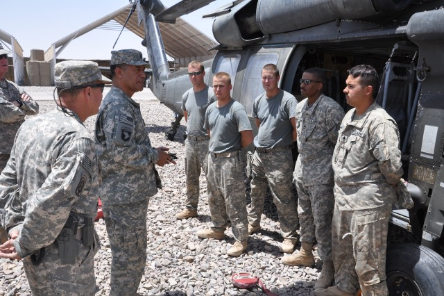 Command Sgt. Maj. Iuniasolua Savusa, International Security Assistance Force command sergeant major, visits two key forward operating bases in southern Afghanistan to assess progress with the ISAF expansion and bid farewell to US personnel serving there. During a July 26 visit to a major FOB at Terin Kout, Savusa takes a moment to praise a US-60 helicopter maintenance crew for the job they are doing, answer questions and address their concerns.
