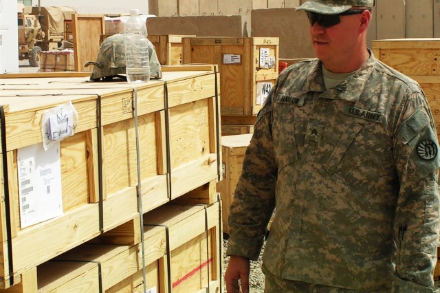 Sgt. Richard Harlow, a Helena, Mont. native, and with the 639th Quartermaster Company double checks items ready to be issued to customers from the supply yard at Victory Base Complex, Iraq.