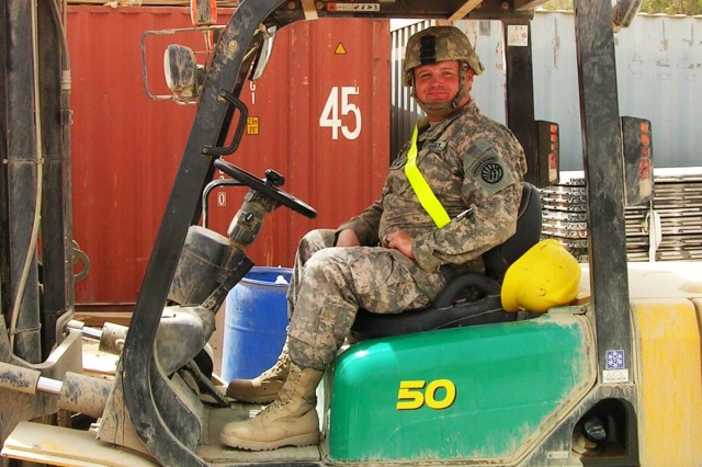 Sgt. Timothy Broadbrooks, a native from Helena, Mont., with the 639th Quartermaster Company prepares to load items for a customer at the supply yard in Victory Base Complex, Iraq.