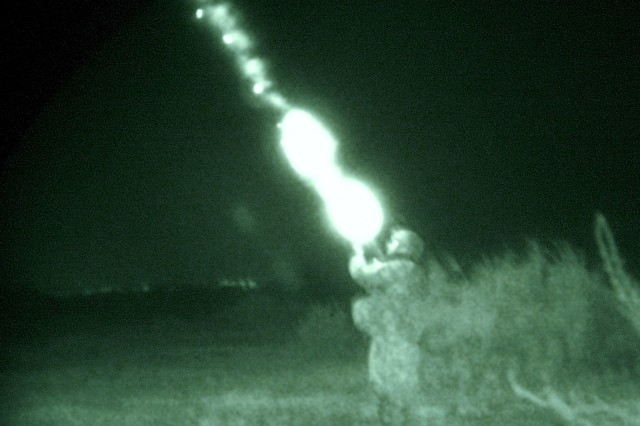 A Soldier with Company B, 120th Combined Arms Battalion, 30th Heavy Brigade Combat Team, headquartered in Whiteville, N.C., fires a flare from his M-203 grenade launcher during a night patrol southeast of Al Dhoura, June 25.  The Soldiers are based out of Forward Operating Base Mahmudiyah.