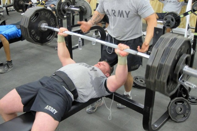 BAGHDAD - Capt. Walter Hatfield, of Charleston, W. Va., bench-presses 425 pounds, breaking the gymnasium's record of 415 pounds at Camp Stryker July 22. Hatfield, of the 150th Armored Reconnaissance Squadron, 30th Heavy Brigade Combat Team, lifts weights during his spare time.  He won the 2005 European National Power-lifting Competition in Germany. Hatfield began his military career in the Marine Corps 15 years ago, and became a member of the West Virginia National Guard in 2000. He is currently the civil military operations officer with the squadron.